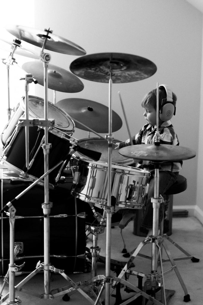 sami roy photography, 3 year old rockstar, black and white drums, toddler playing the drums