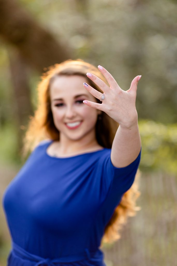 bride showing ring, engagement session