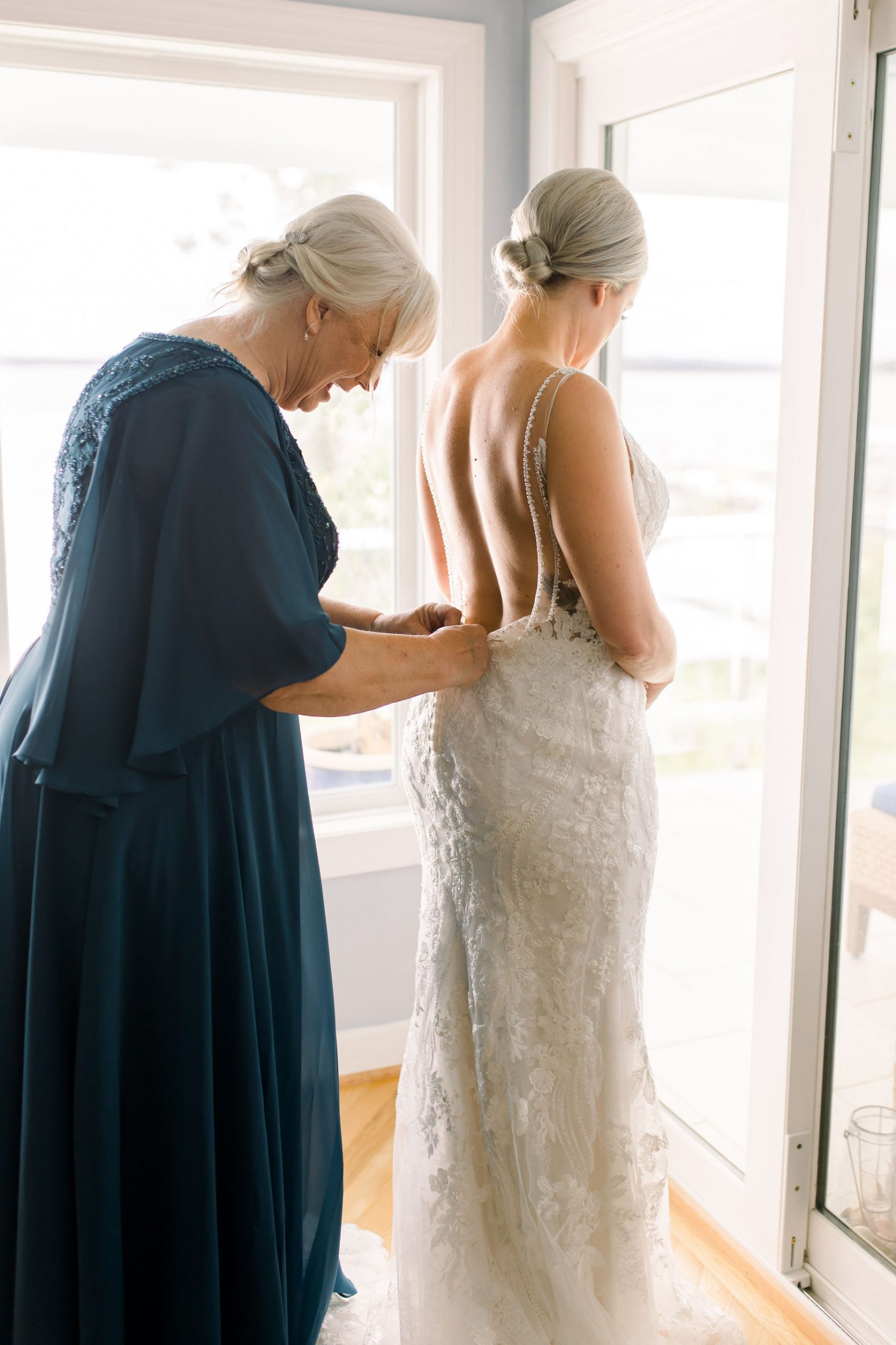 Mother helping bride